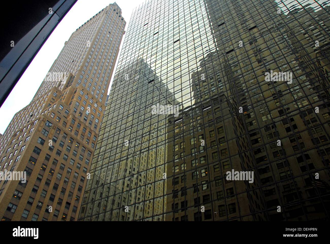 Reflection of The Chrysler Building in the Grand Hyatt Hotel. The Chanin building is on the left.Midtown East, Manhattan, New - Stock Image