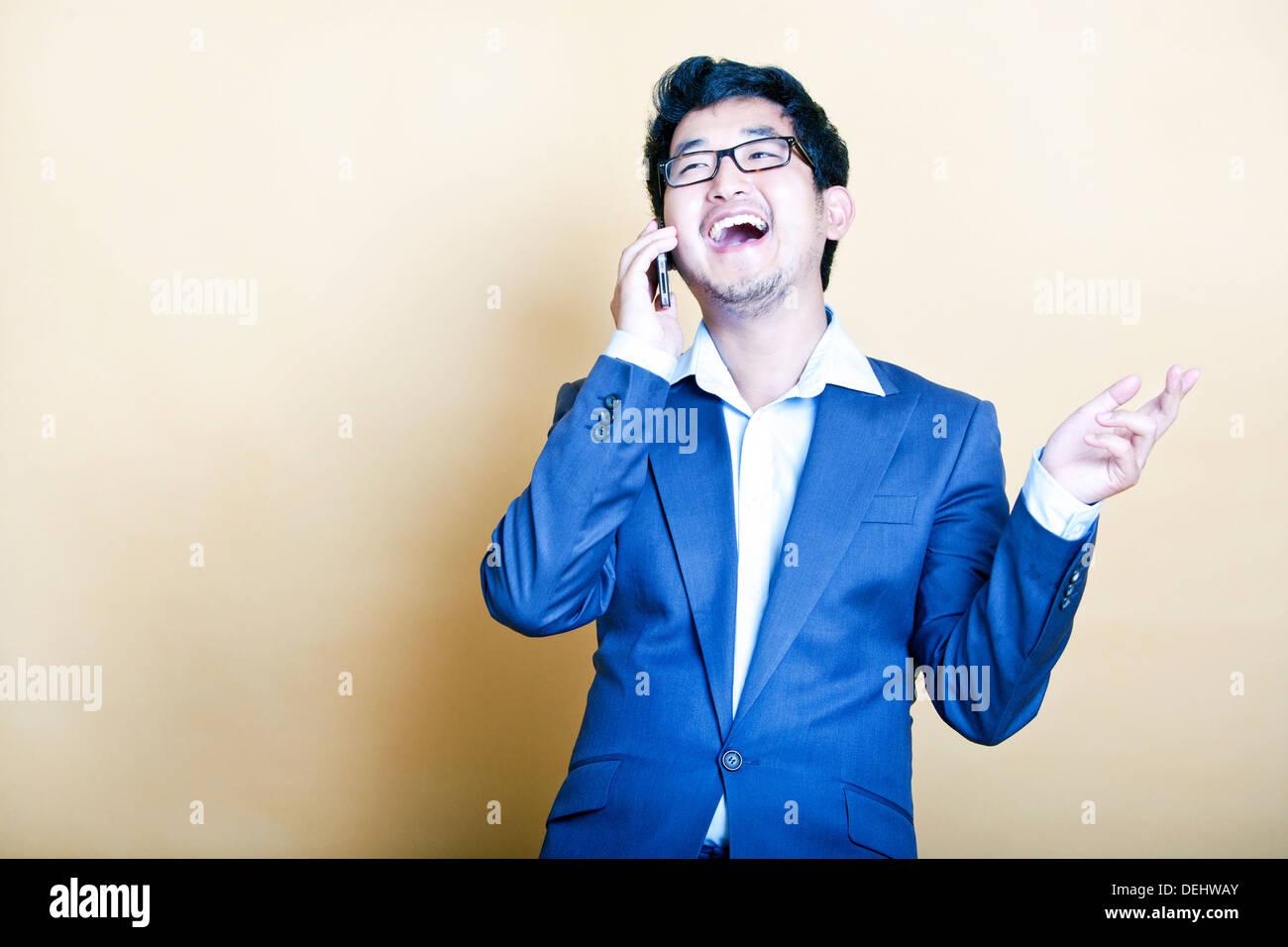 Stylish Asian man on the telephone - Stock Image