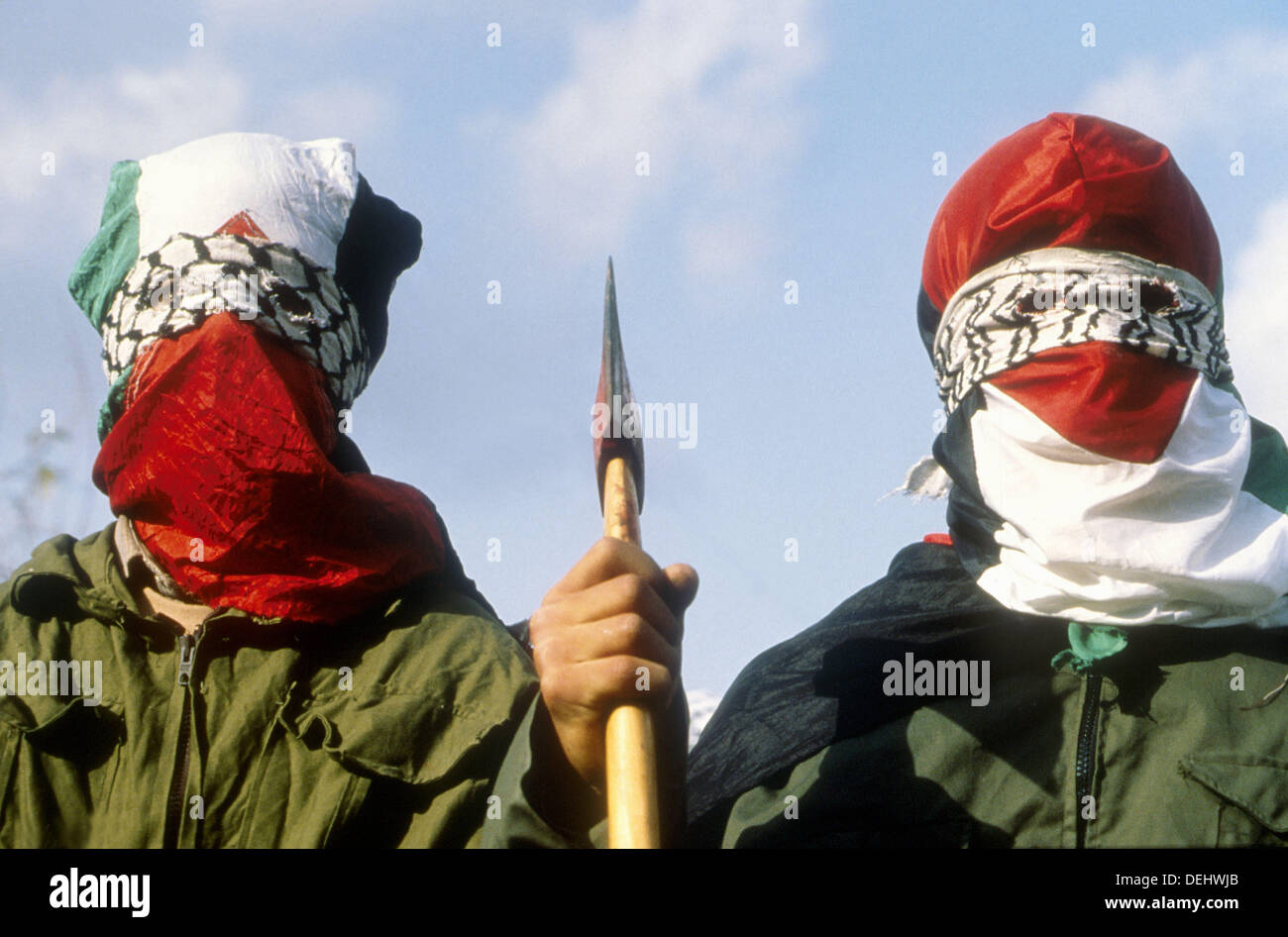 Masked young palestinians during Intifada, year 2002. The Fatach movement was rioting in Bet Furik village. West - Stock Image