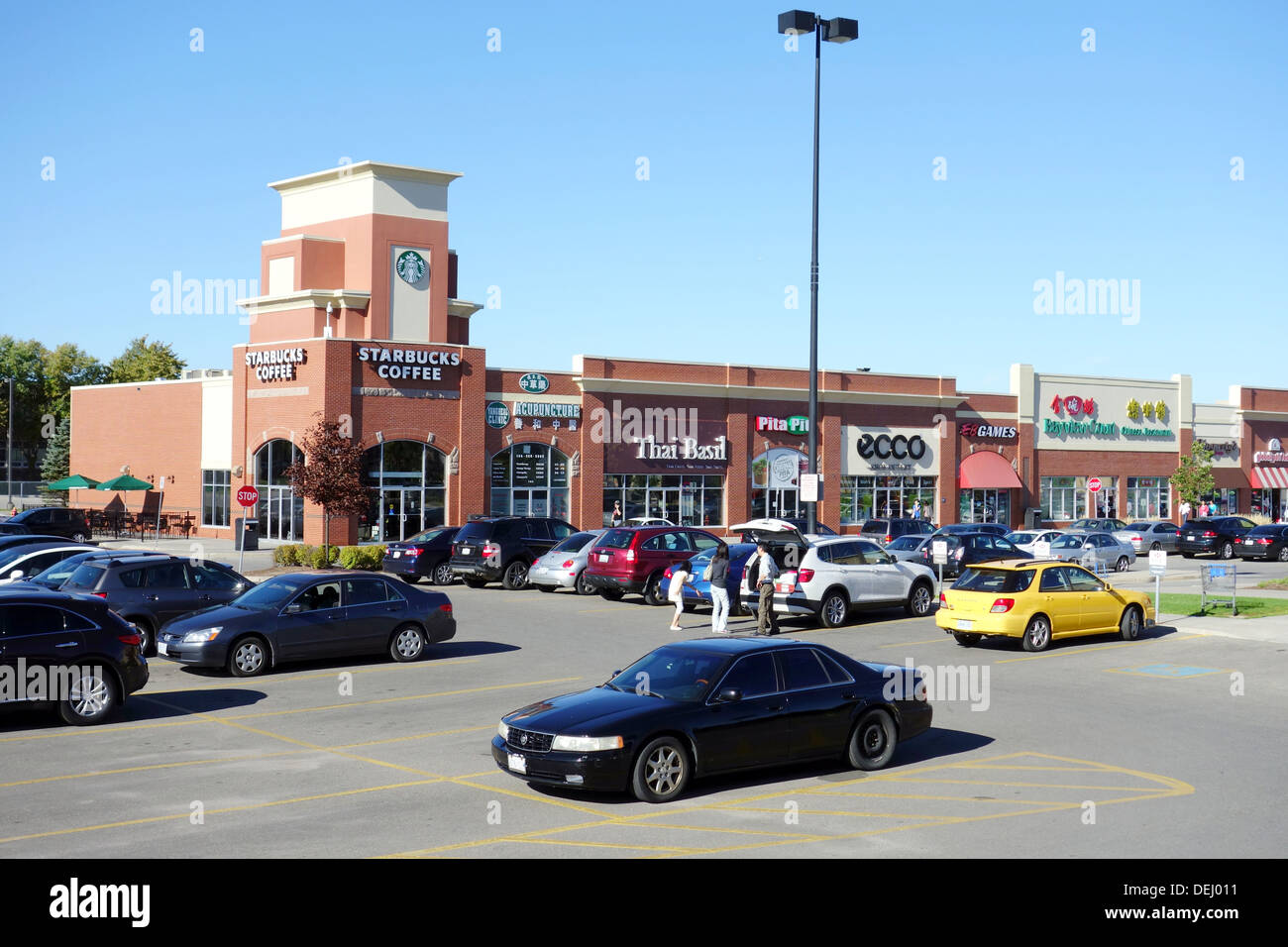 Strip mall parking lot outside Toronto, Canada - Stock Image