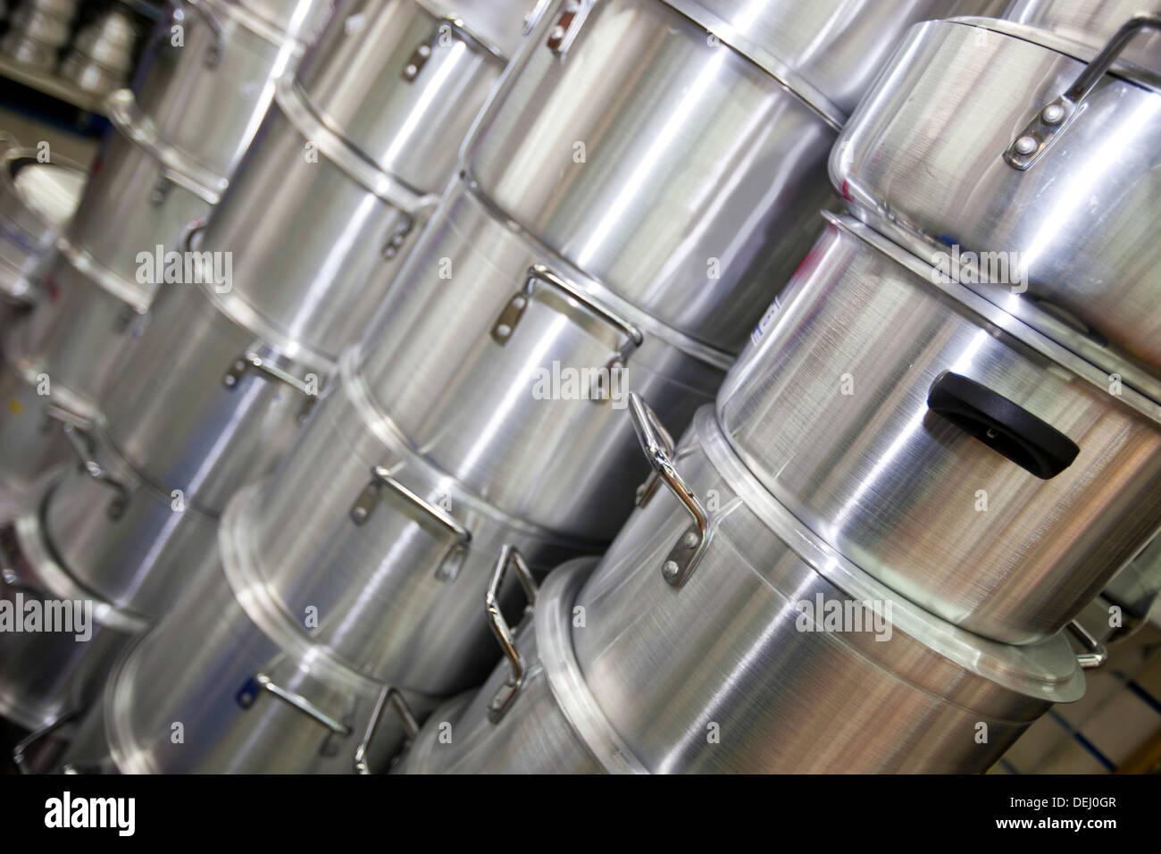 Stacked kitchen utensils supermarket - Stock Image