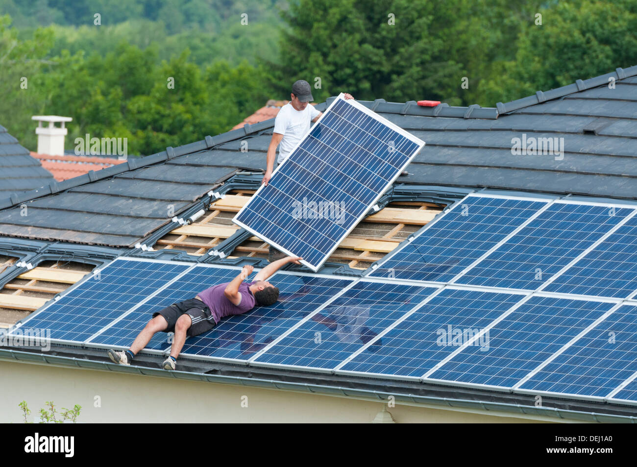 Installation Of Photovoltaic Solar Panels On Roof Of House