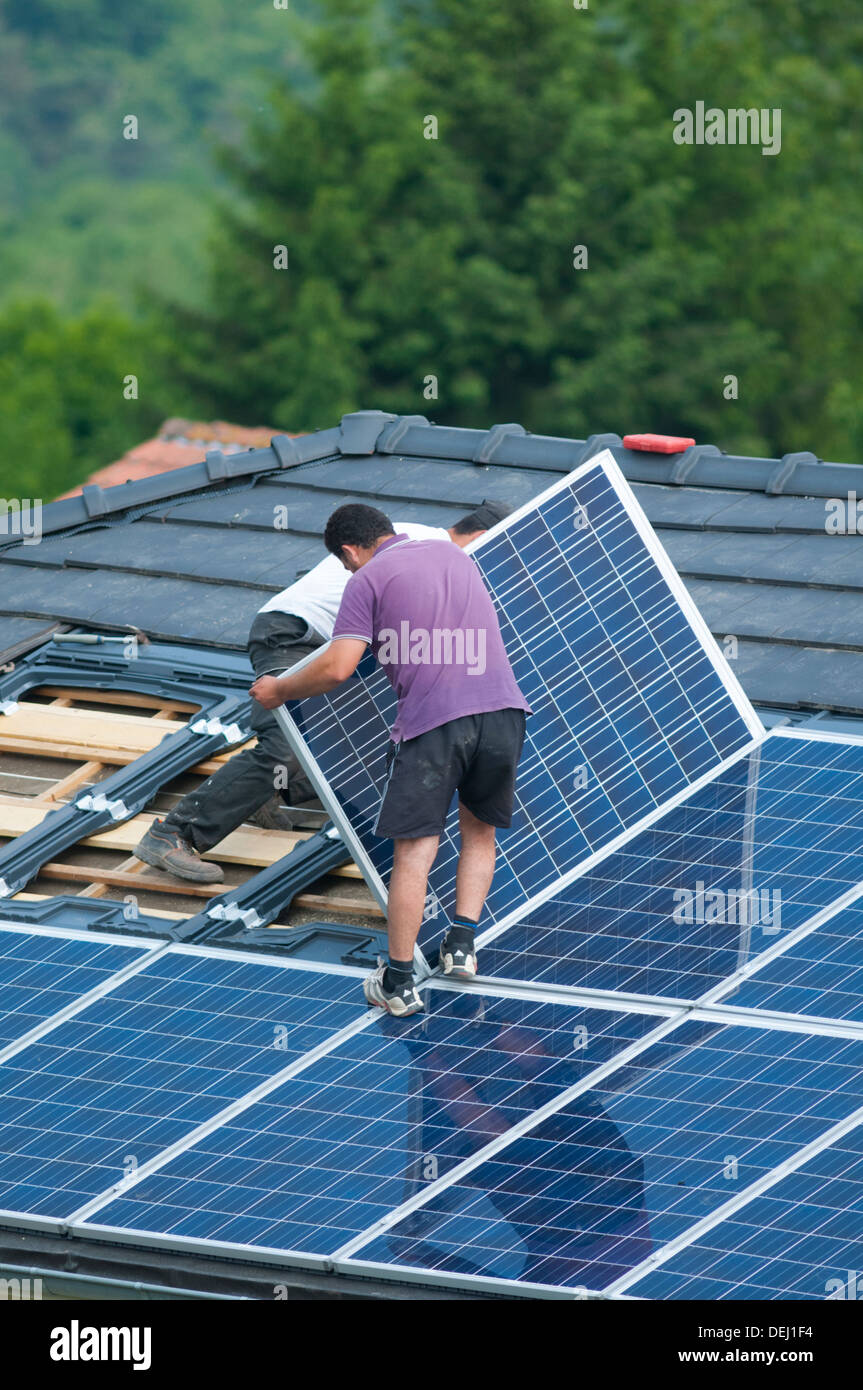 Installation of photovoltaic solar panels on roof of house, Germany - Stock Image