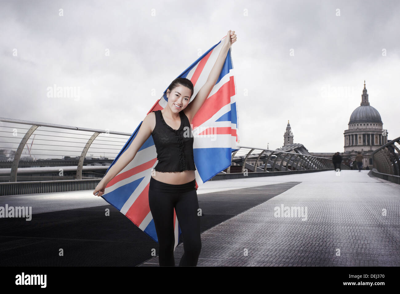 Olympic competitor with Union Jack front St Paul's Cathedral London - Stock Image