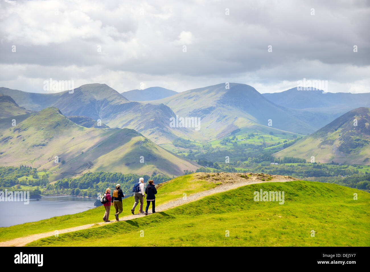 Walkers, Lake District National Park, England. On Latrigg fell above Keswick. Derwentwater, Cat Bells and Newlands Valley behind - Stock Image