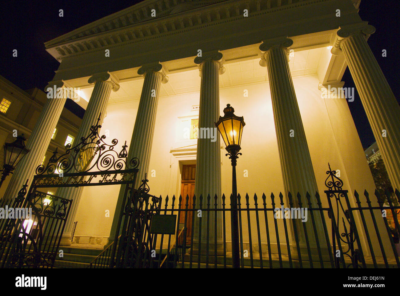 Night scene of Hibernian Hall on Meeting Street in the historic district of Charleston, South Carolina Stock Photo