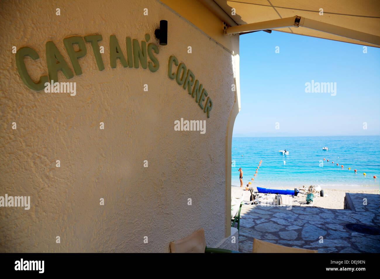 Agio ag Nikitas town captain's corner taverna overlooking beach sea coast Lefkas Lefkada Greek Island Greece - Stock Image