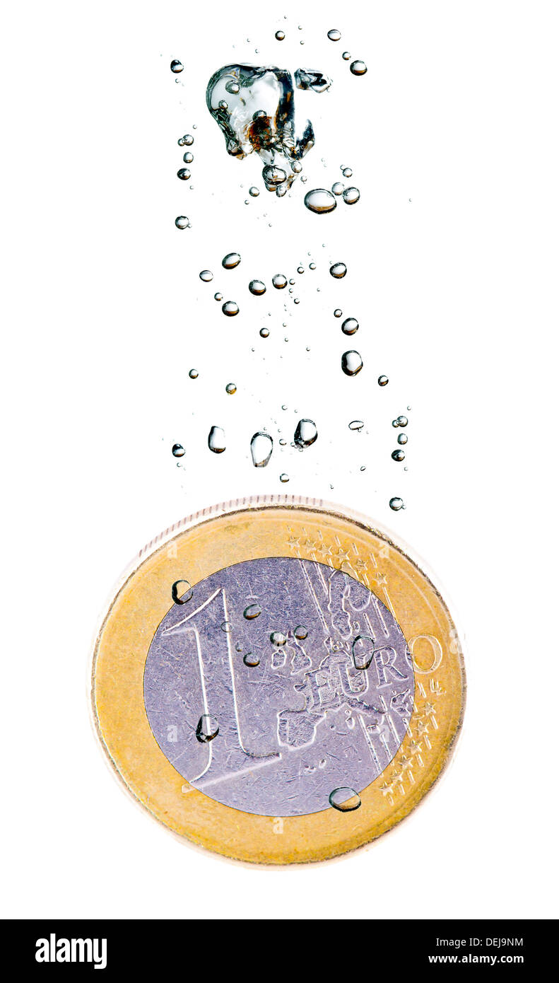 Concept with euro coin sinking in water over a white background - Stock Image