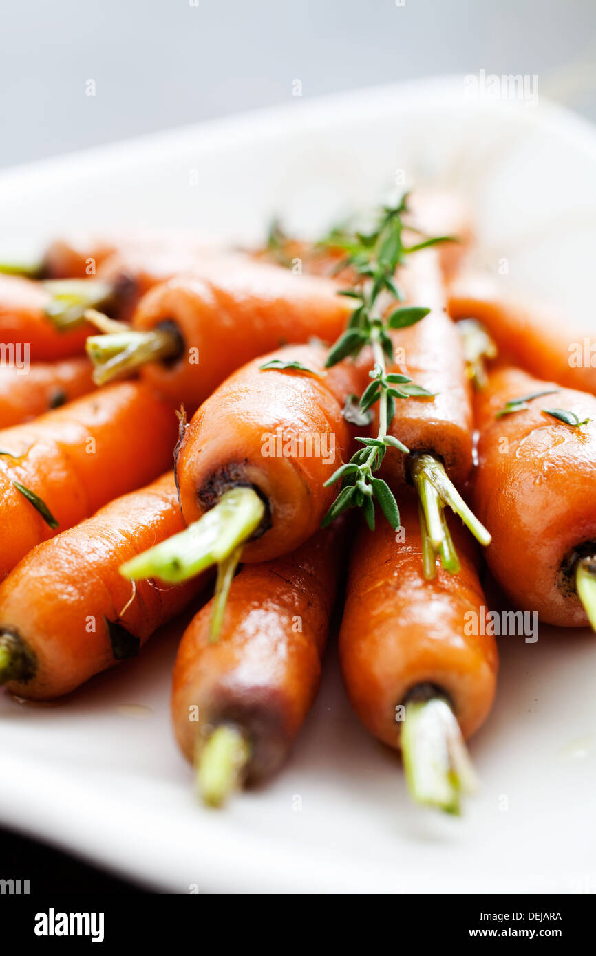 Close up of carrots with fresh thyme  Stock Photo