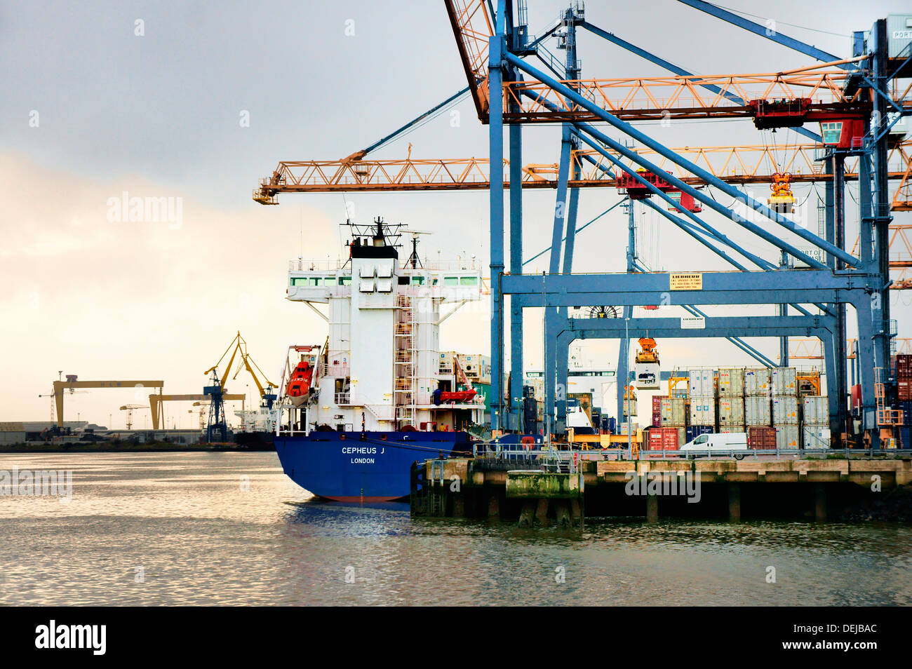 Belfast Harbour, Port of Belfast, Northern Ireland. Container ship dock facility on west bank with Harland and Wolff in distance - Stock Image