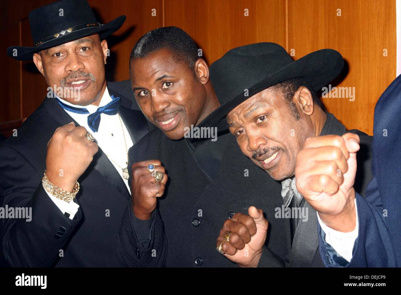 FILE PICS: September 18, 2013 - Kenneth Howard Norton Sr. (August 9, 1943 - September 18, 2013) was an American former heavyweight boxer and former WBC world Heavyweight Champion. He was best known for his 12-round victory over M. Ali, when he famously broke Ali's jaw, on March 31, 1973, becoming only the second man to defeat a peak Ali as a professional. PICTURED: Oct 10, 2004 - New York, New York, U.S. - From left, KEN NORTON, MARVIS FRAZIER, and JOE FRAZIER arrives at the first annual black tie gala F.I.S.T. Fights for New York. Credit:  ZUMA Press, Inc./Alamy Live News - Stock Image