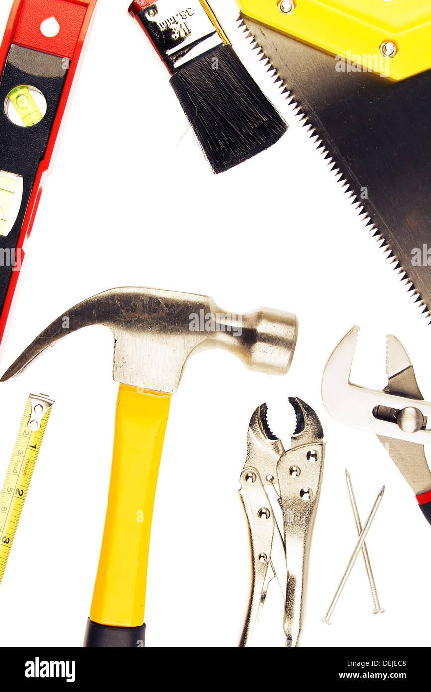 Varied tools on plain background - Stock Image