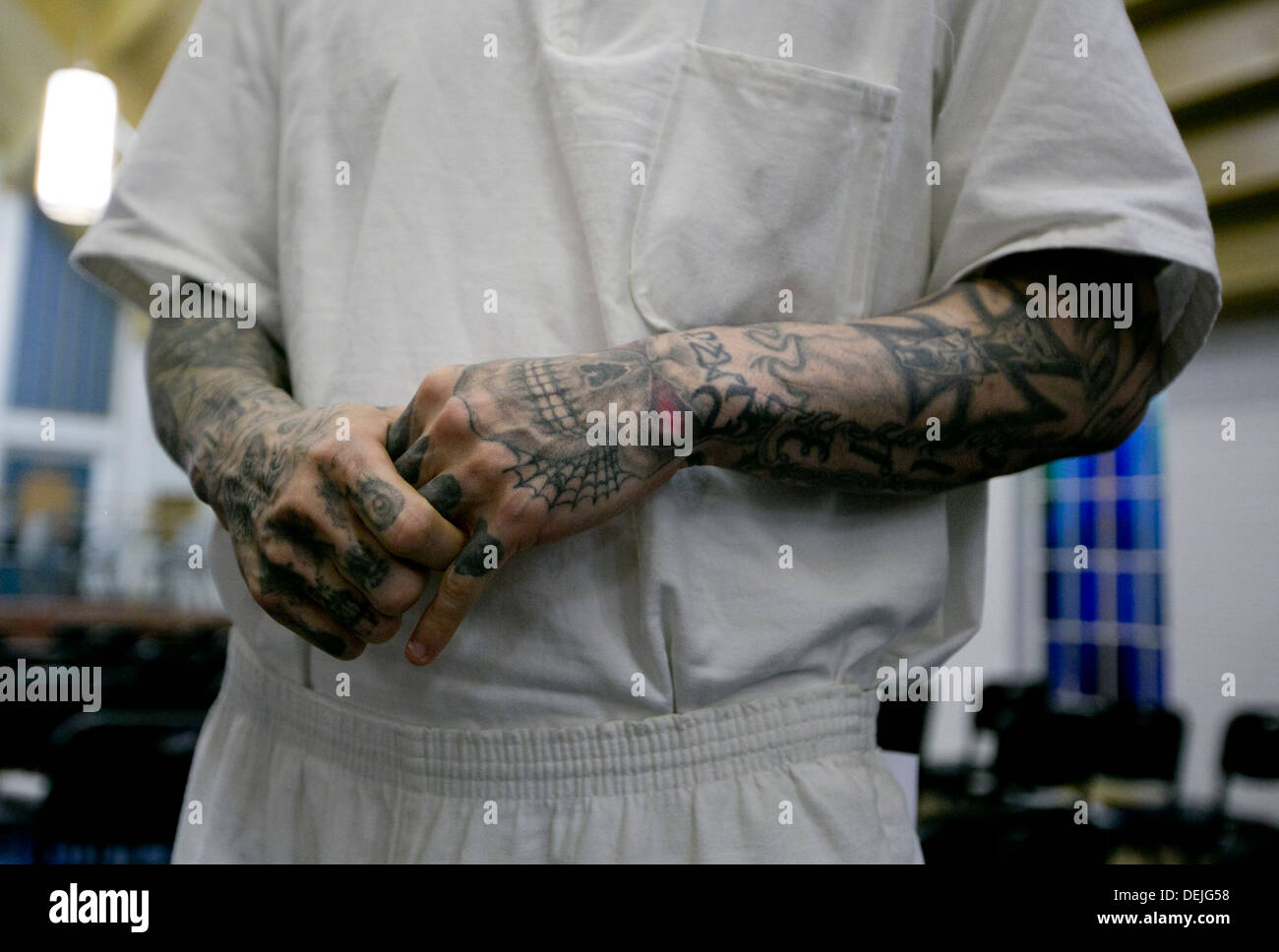 Male inmate with various tattoos on his arms inside maximum security ...