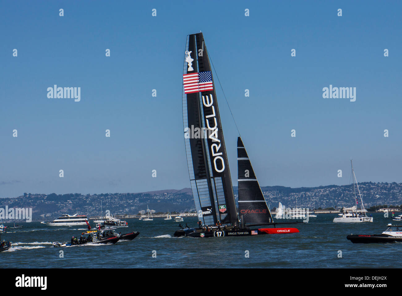 Oracle Team USA catamaran in the America's Cup Race on September 12th in San Francisco Bay followed by flotilla - Stock Image