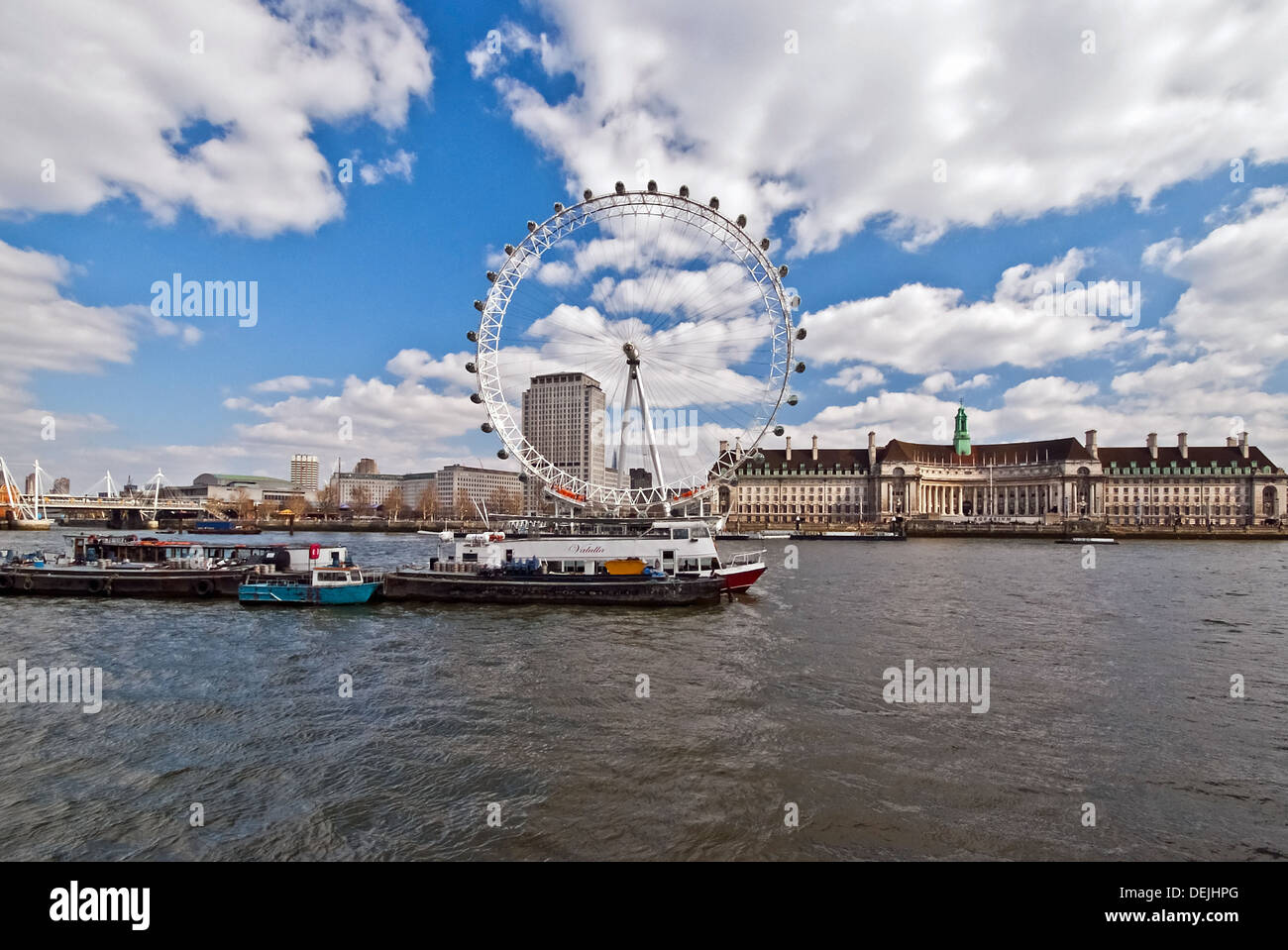 River Thames and cruise Boats with the Millennium Wheel in Background - Stock Image