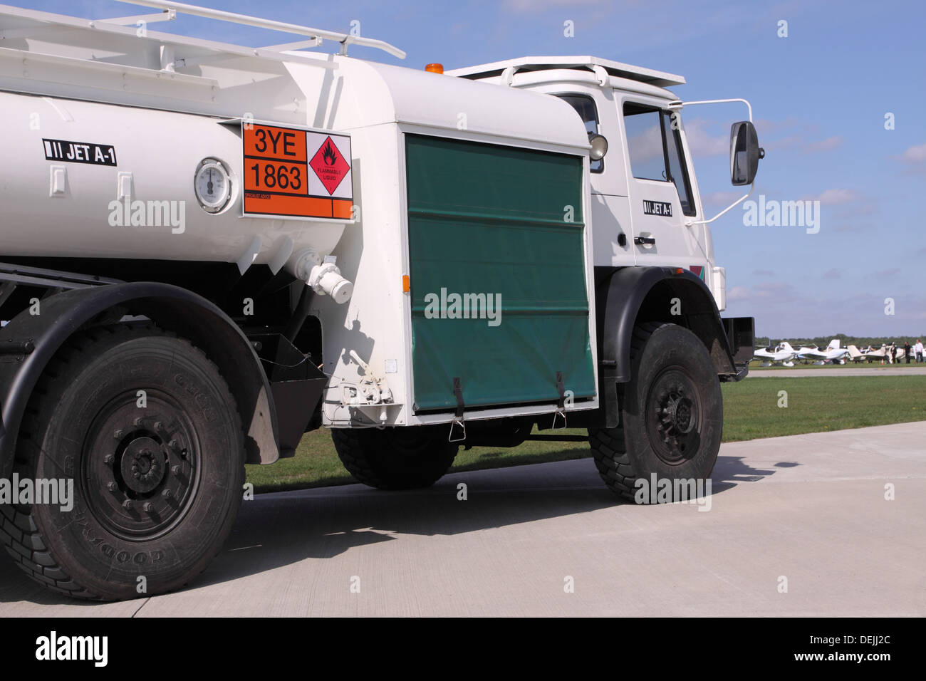 Airport fuel truck bowser vehicle with JET A-1 aviation fuel with HAZCHEM sign - Stock Image