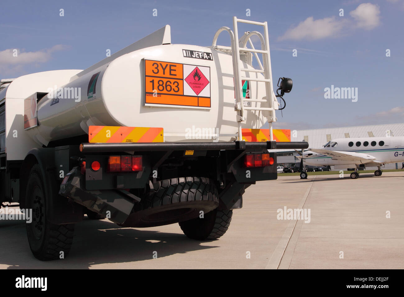 Airport aviation fuel truck with JET A1 aero fuel and HAZCHEM sign at airport in UK Stock Photo