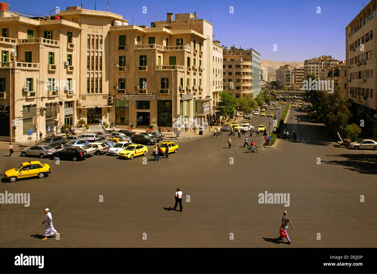 Modern city by the Hejaz Railway station and the famed Orient Palace Hotel, Damascus, Syria - Stock Image