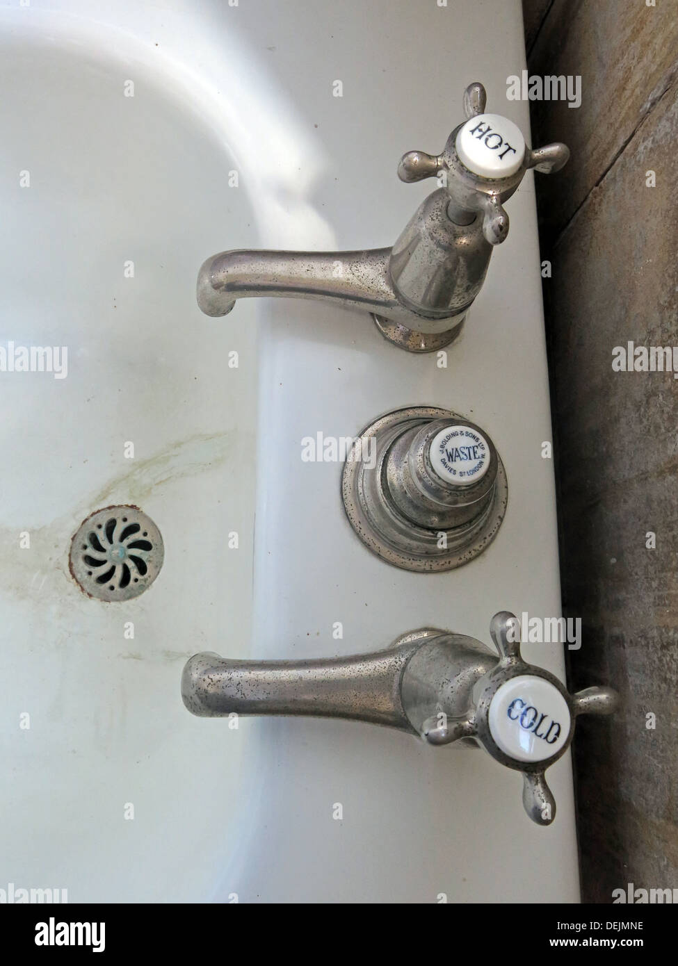 Overview of sink taps, bathroom detail at Barrington Court, Ilminster, Somerset , UK TA19 0NQ - Stock Image