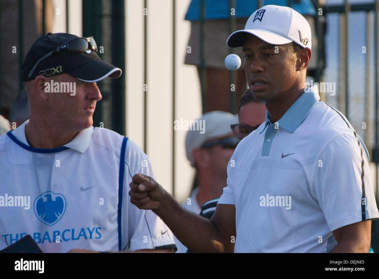 Aug. 21, 2013 - Jersey City, New Jersey, U.S - August 21, 2013: Tiger Woods (USA) watches the ball after he flips Stock Photo