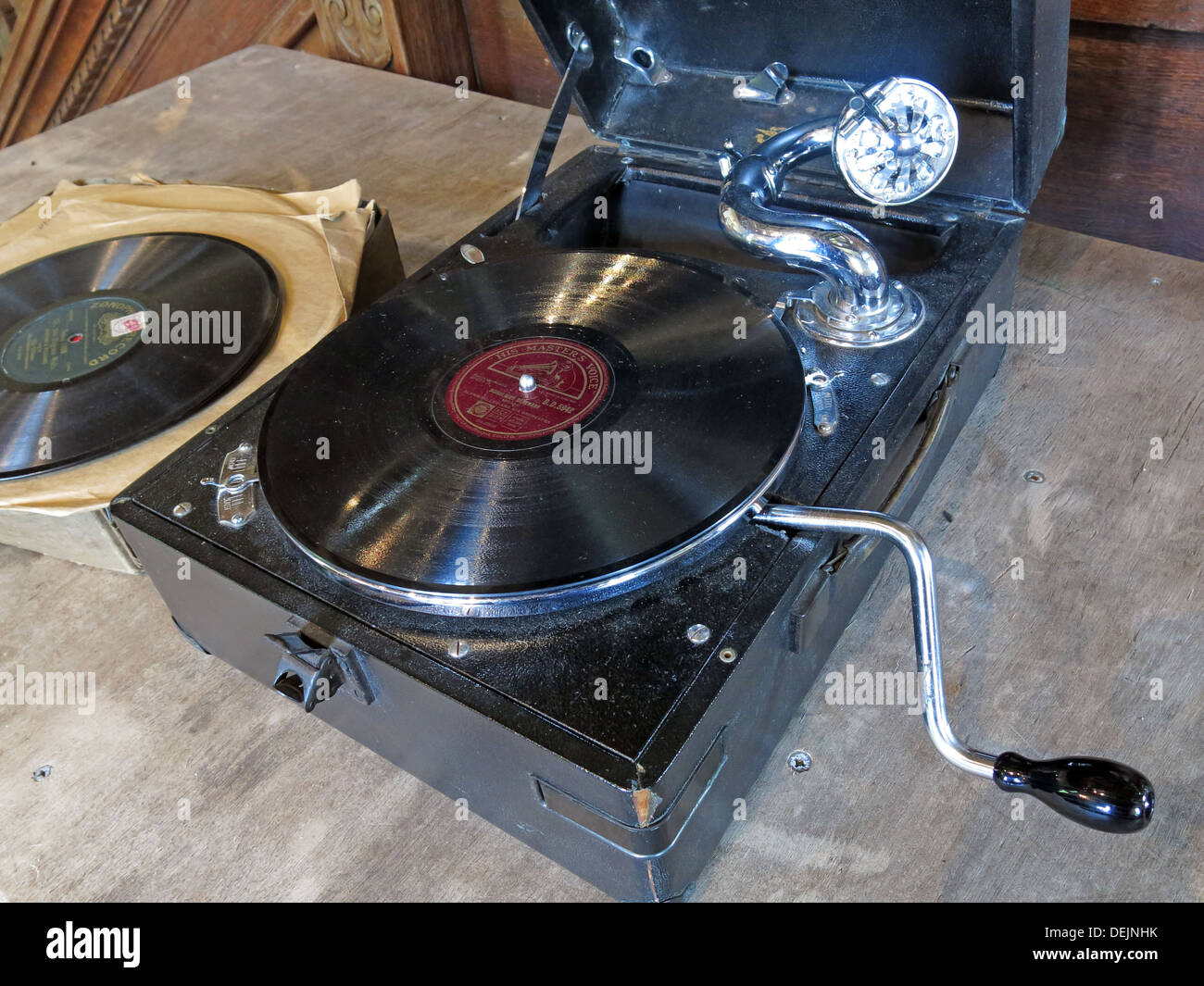 Portable Wind Up Gramophone Record Player with 78rpm Vinyl record, England, UK - Stock Image