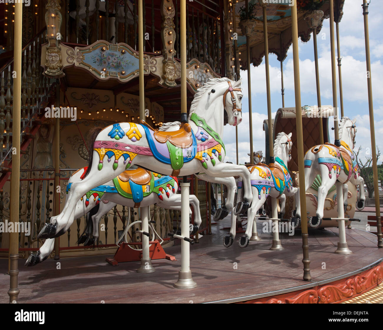 Close up of Horses on an Old Fashioned French style Carousel in Paris France, also called a Merry-go-Round. - Stock Image