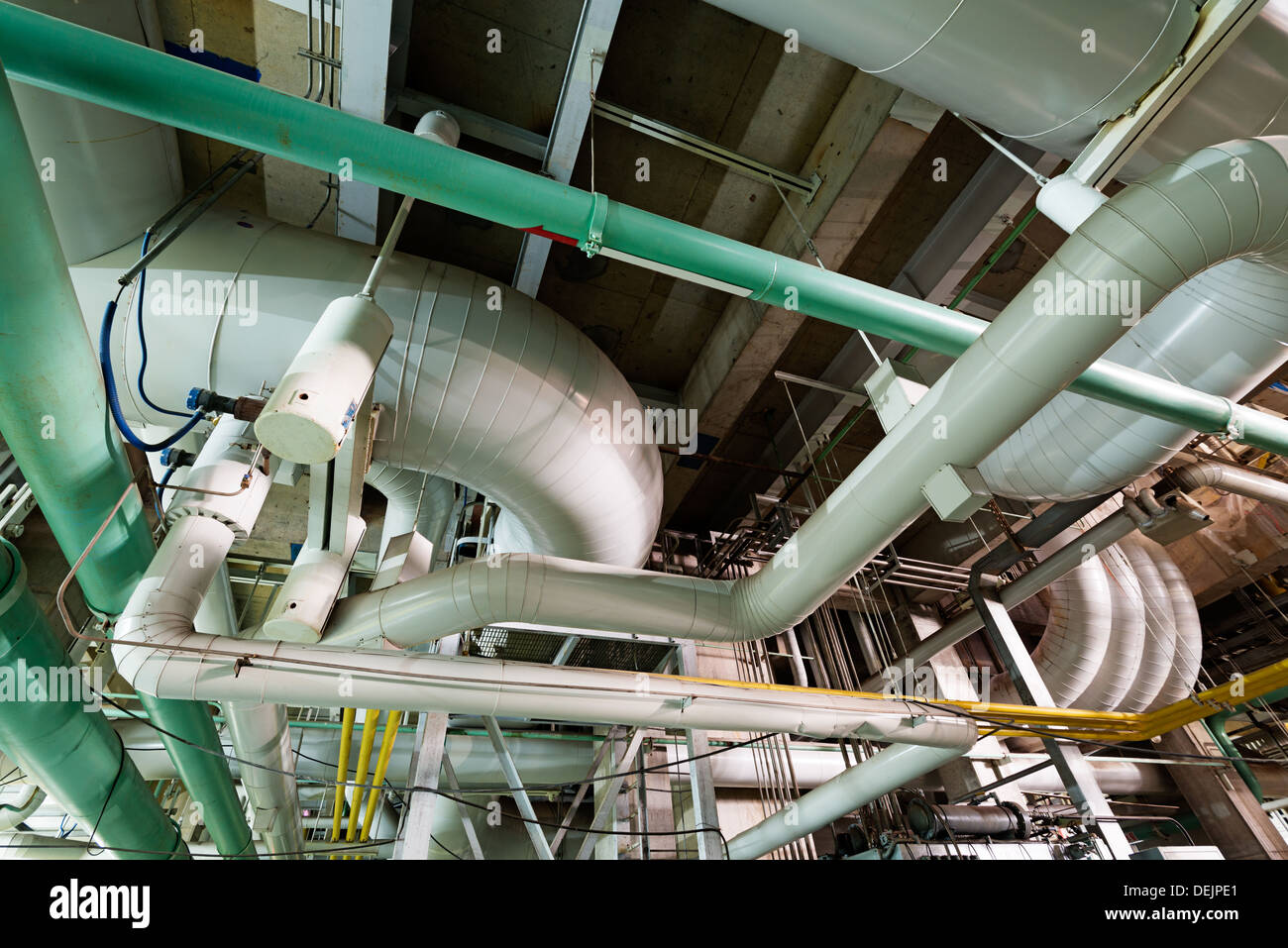 Equipment, cables and piping as found inside of industrial power plant Stock Photo