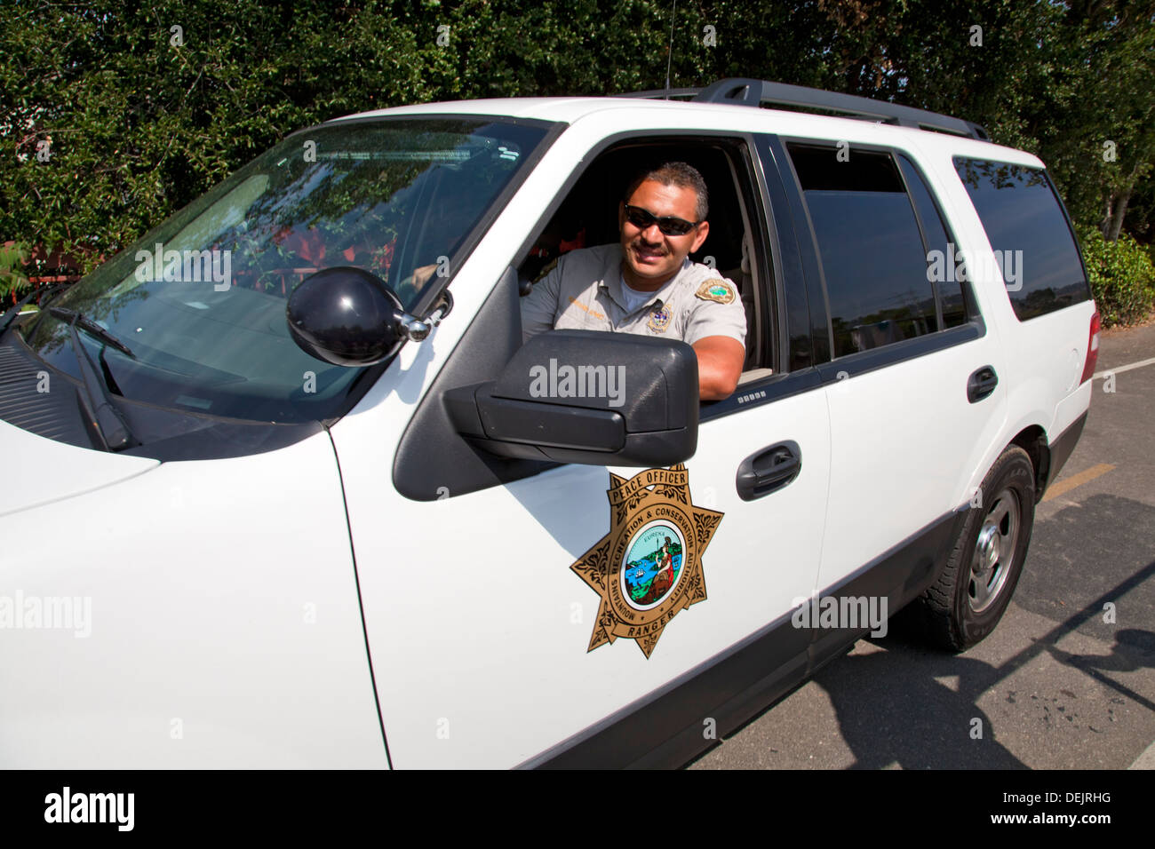 Mountains, Recreation and Conservation Authority (MRCA) Ranger patrolling the Los Angeles River, California, US - Stock Image