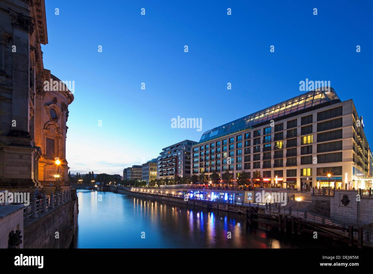 Twilight view of the Radisson Blu Hotel with the back end of the BerlinerDom on the left  Mitte, Berlin, Germany - Stock Image