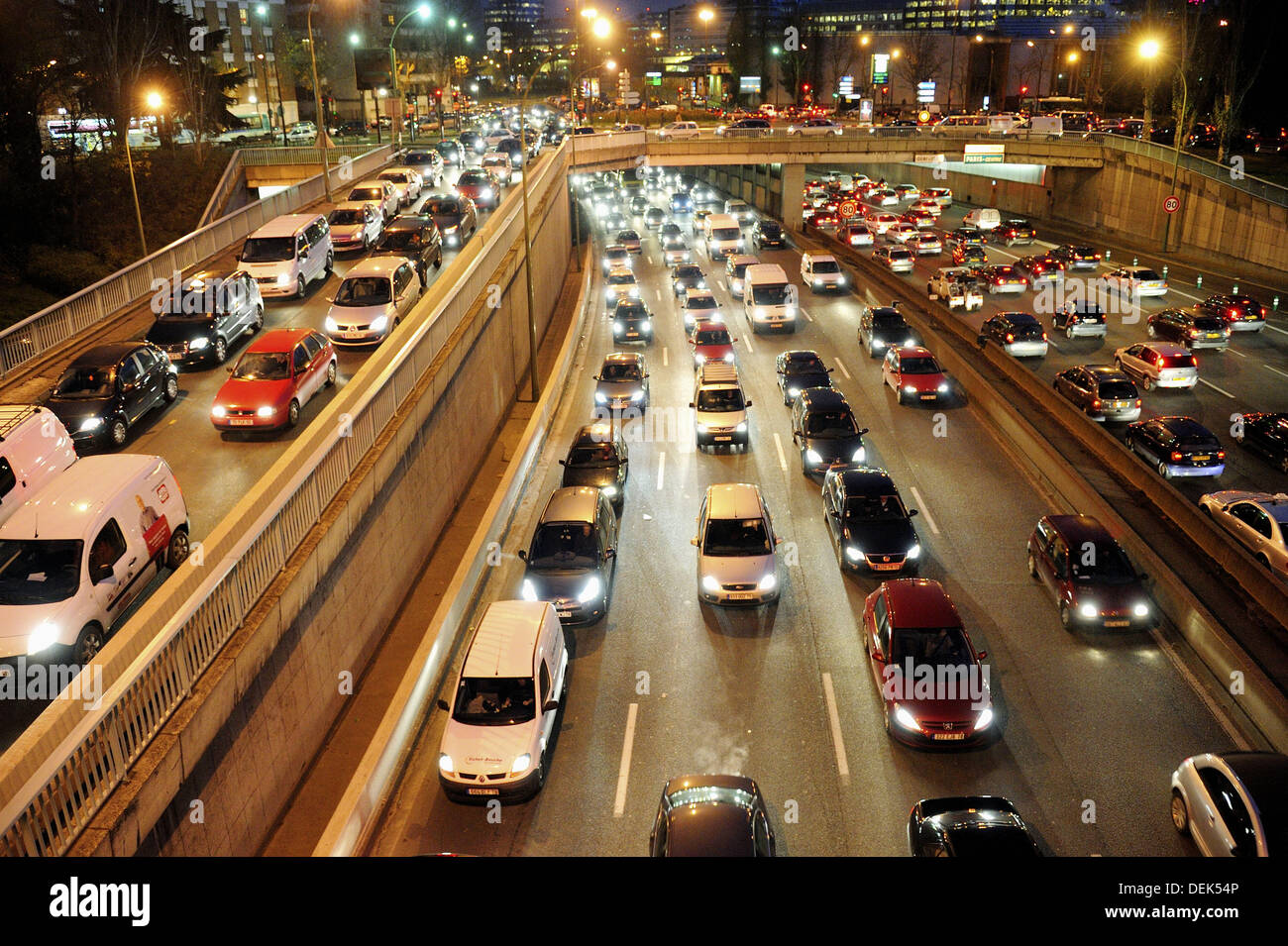 Pollution, traffic jam on parisian expressway, Peripherique at night, Porte de Saint Cloud, Paris, France - Stock Image