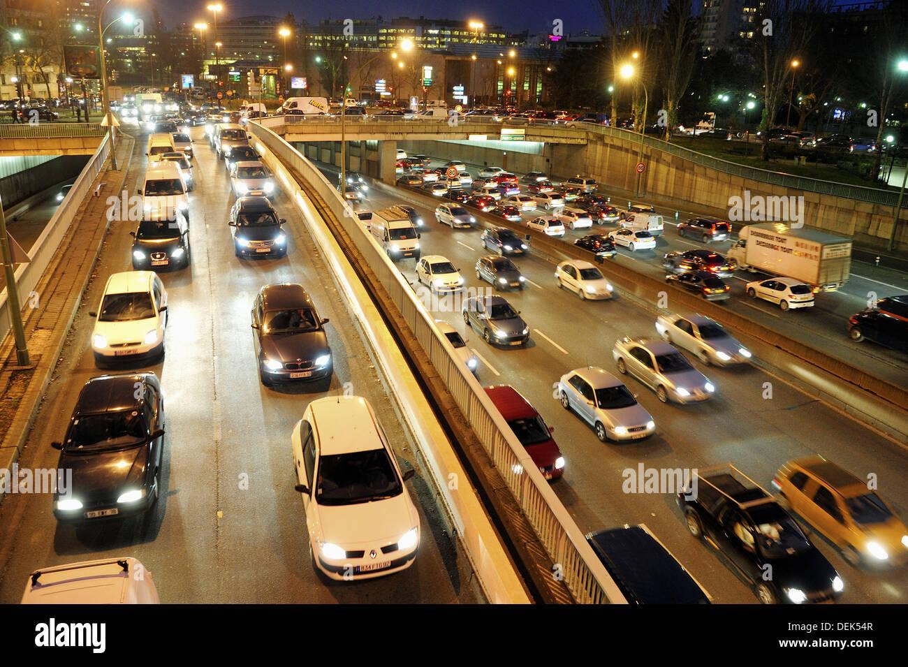 Pollution, traffic jam on parisian expressway, Peripherique at night, Porte de Saint Cloud, Paris, France - Stock Image