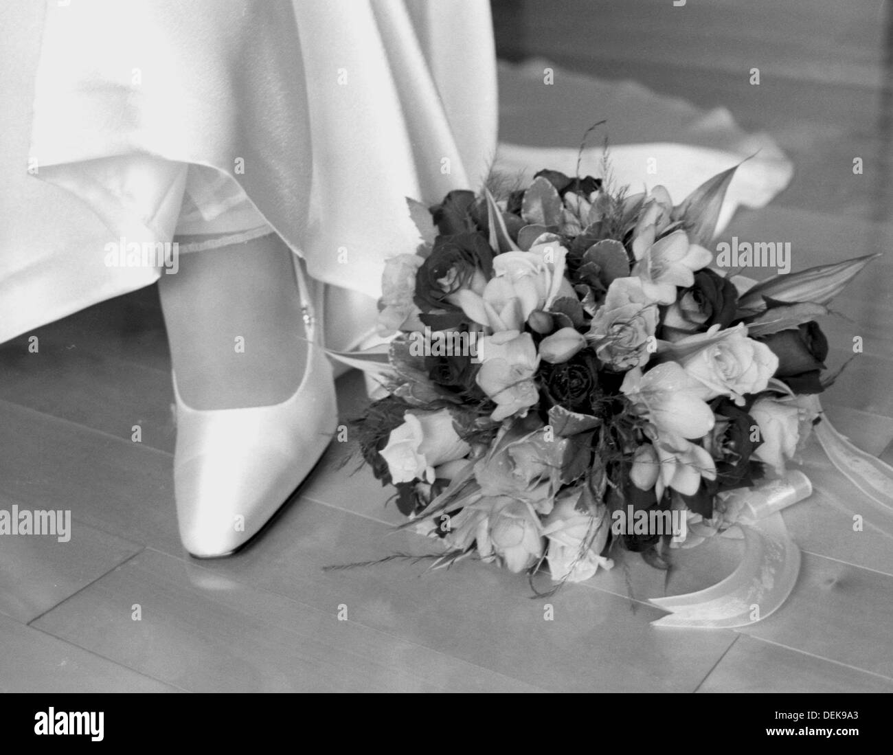 Location shot of wedding flowers & bridal shoes. Vancouver BC Canada - Stock Image