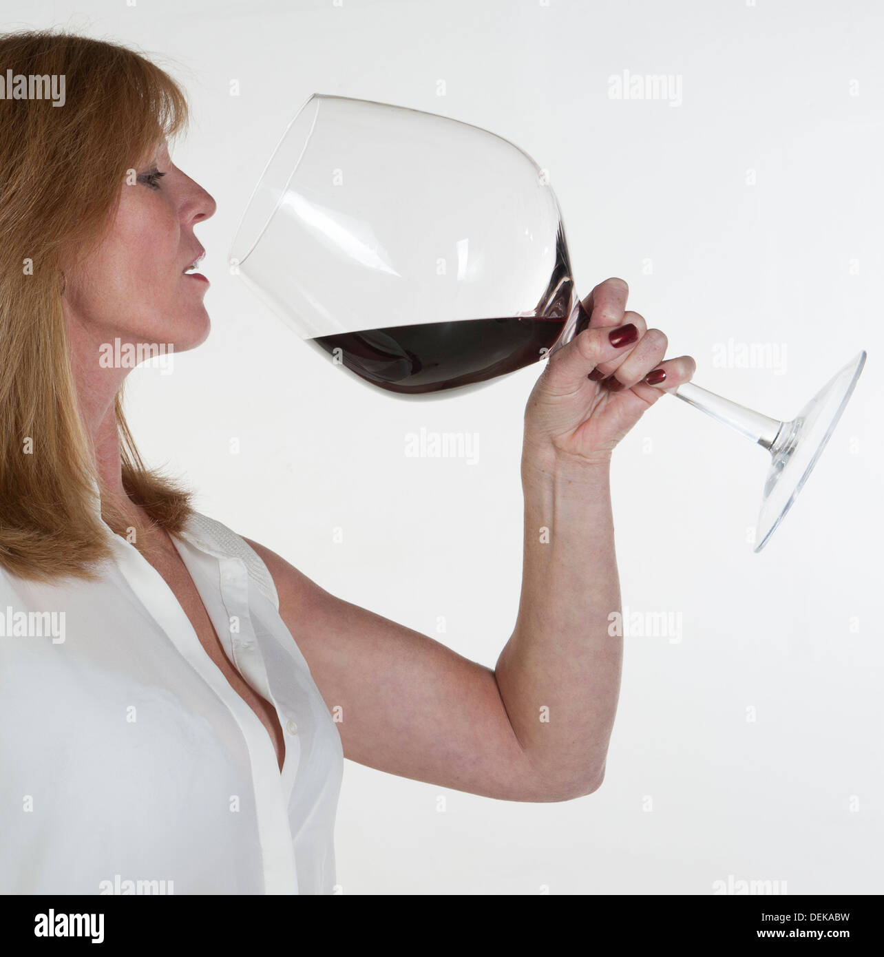 Picture Of Woman Drinking Huge Glass Of Wine