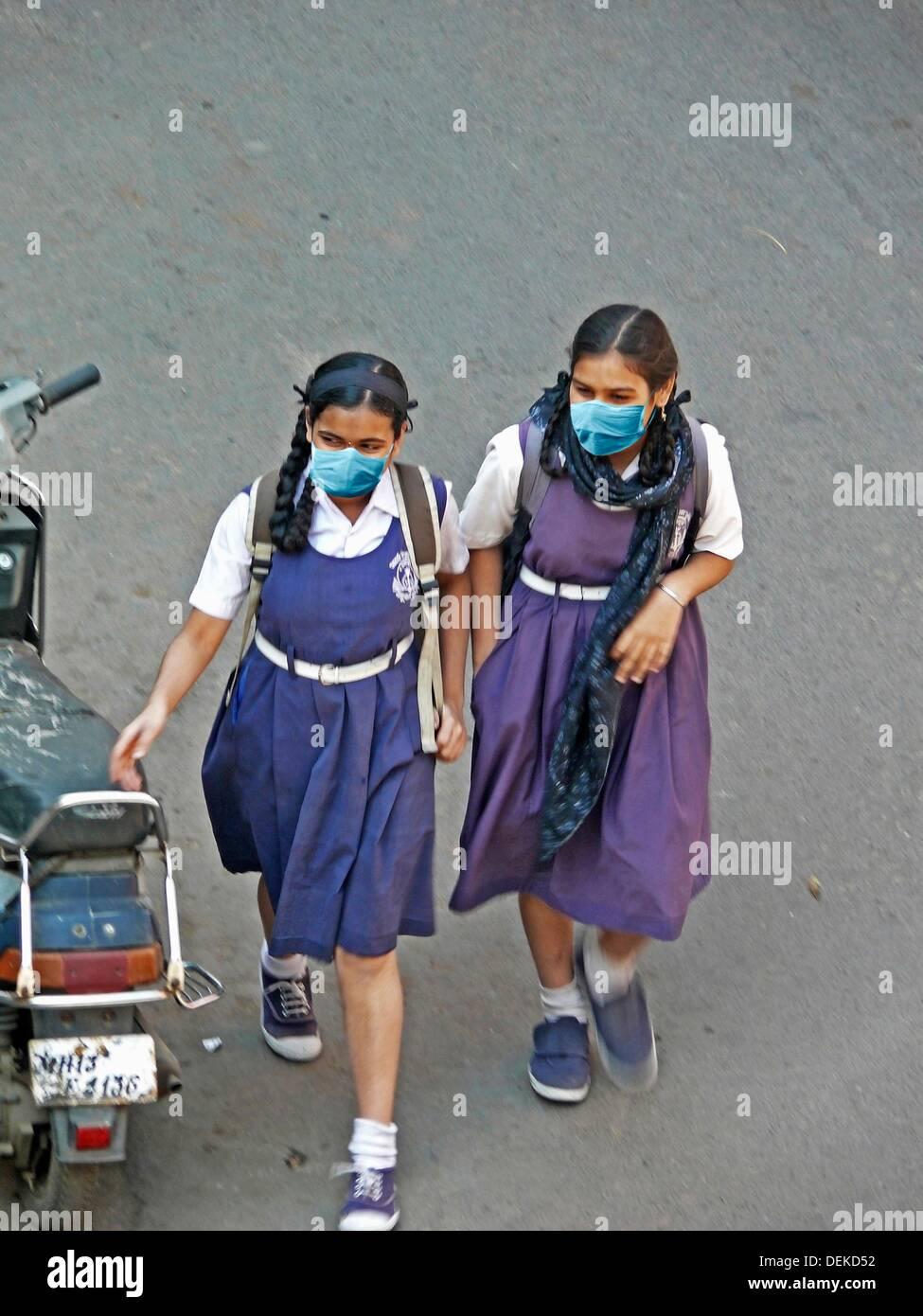 Schoolgirls, Precaution Mask for Swine Flu, H1N1 Stock Photo
