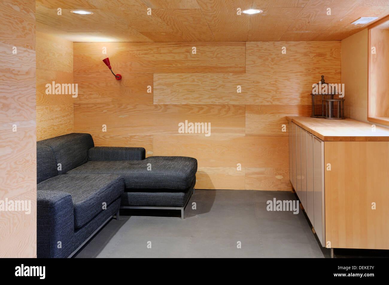 Sofa in wood paneled modern craftsman living room Stock ...