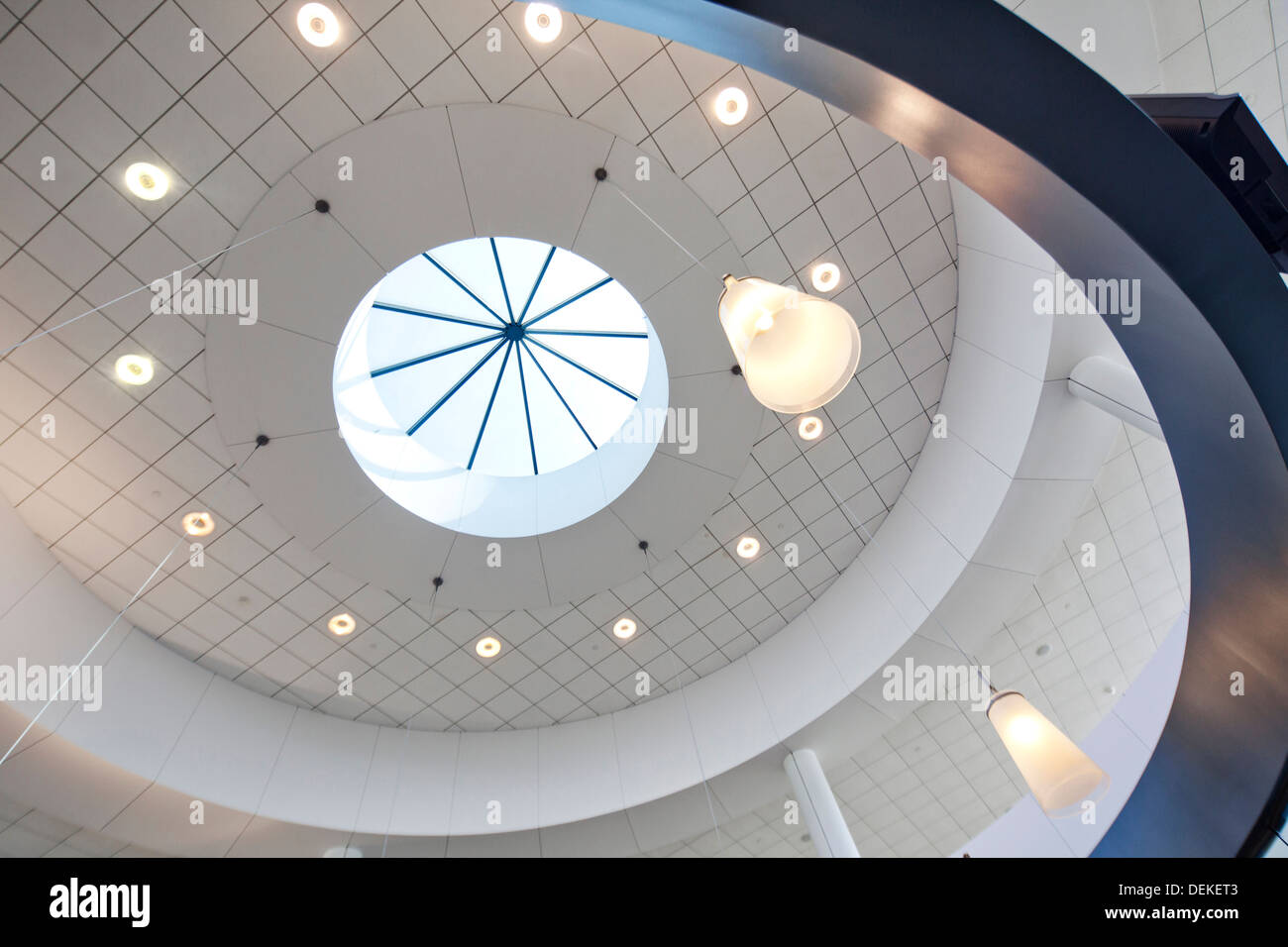 Recessed lights and skylight in domed ceiling - Stock Image