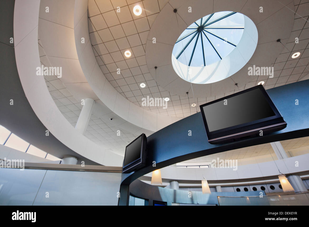 Recessed lights and skylight in ceiling - Stock Image