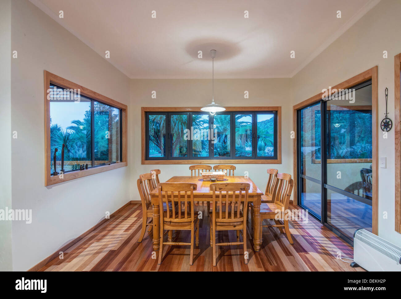 Dining table and chairs in dining room - Stock Image
