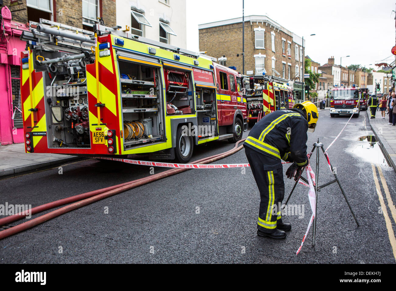 Emergency services Firefighters from the London Fire Brigade respond to an emergency in Stoke Newington, London. - Stock Image