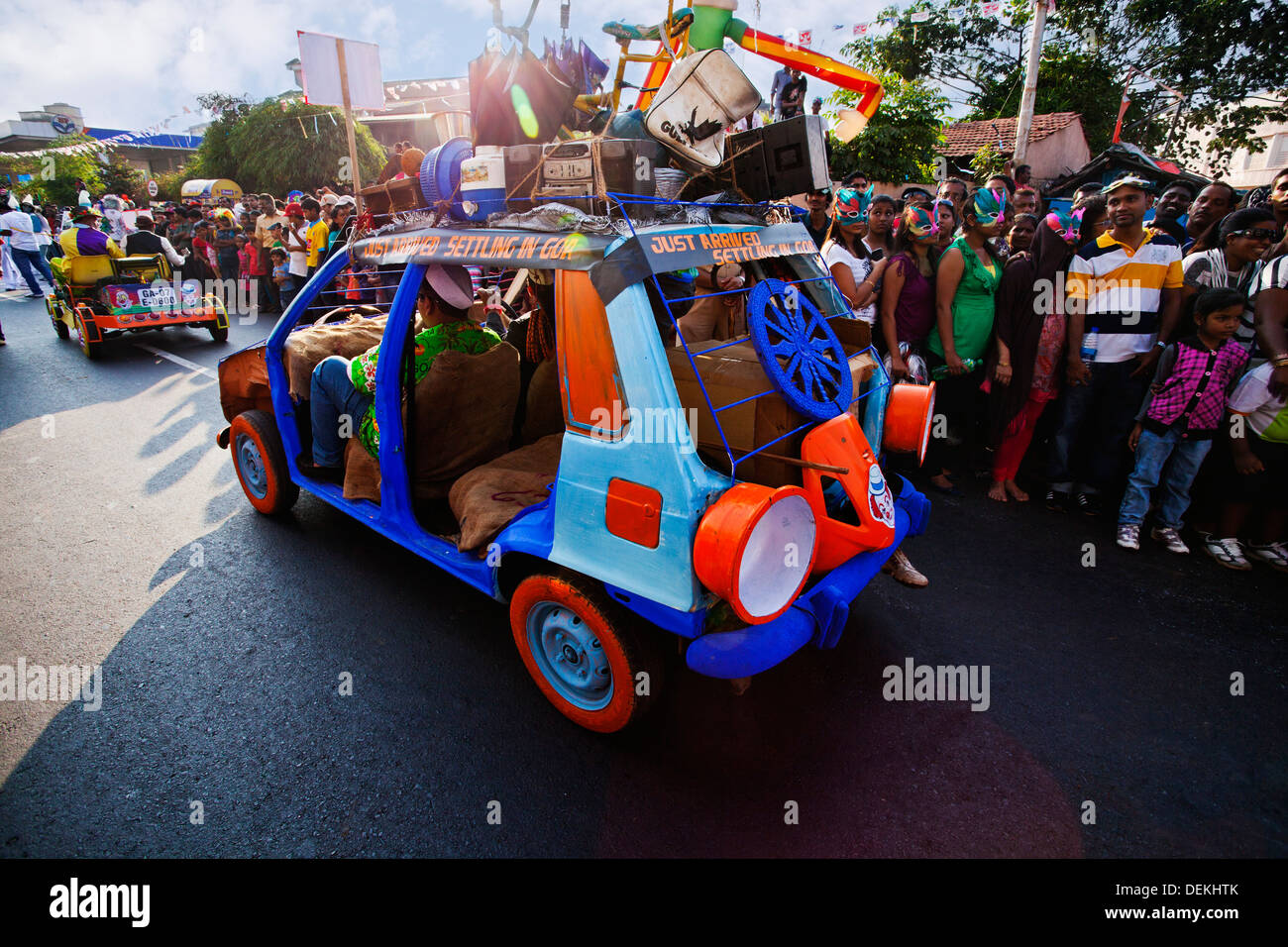 Vintage car at traditional procession in a carnival, Goa Carnivals, Goa, India - Stock Image