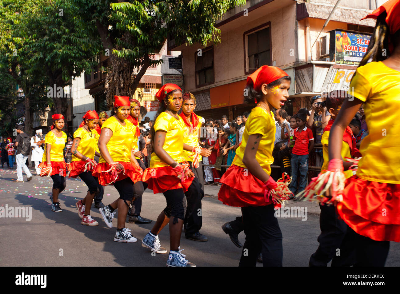 Girls performing during a procession in a carnival, Goa Carnivals, Goa, India - Stock Image