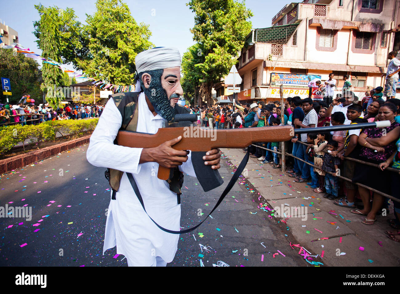Man acting as terrorist during a procession in a carnival, Goa Carnivals, Goa, India - Stock Image