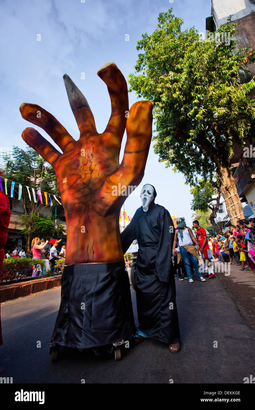 Representation of a human hand during a procession in a carnival, Goa Carnivals, Goa, India - Stock Image