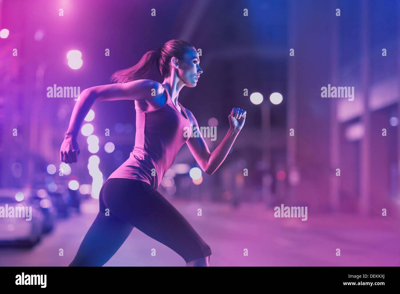 Caucasian woman running on city street Stock Photo