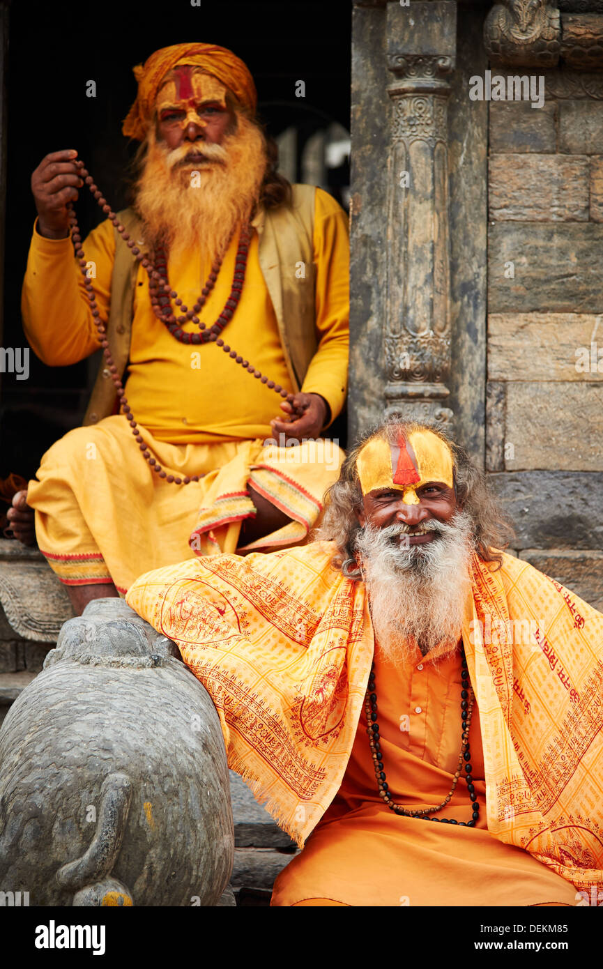 A Sadhu (ascetic religious man, usually a yogi) poses for photos at Pashupatinath Temple, Kathmandu, Nepal - Stock Image