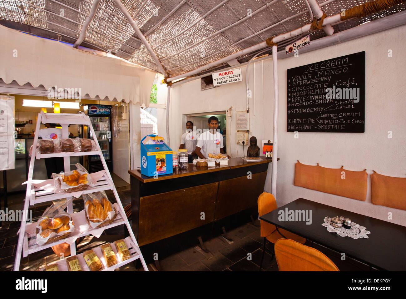Counter clerk at a counter, Lila Cafe, Calangute, North Goa, Goa, India - Stock Image