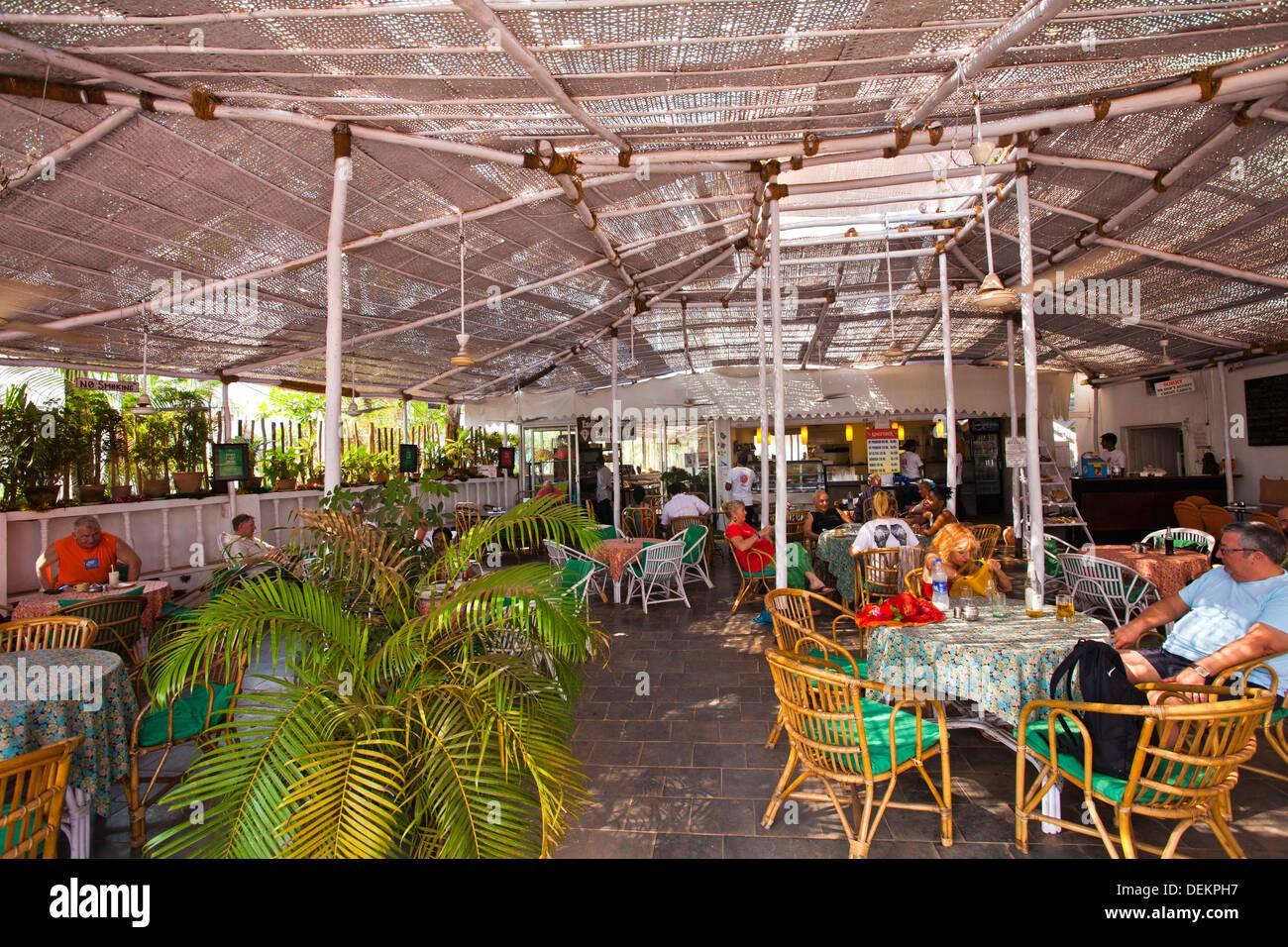 Tourists in a restaurant, Lila Cafe, Calangute, North Goa, Goa, India - Stock Image