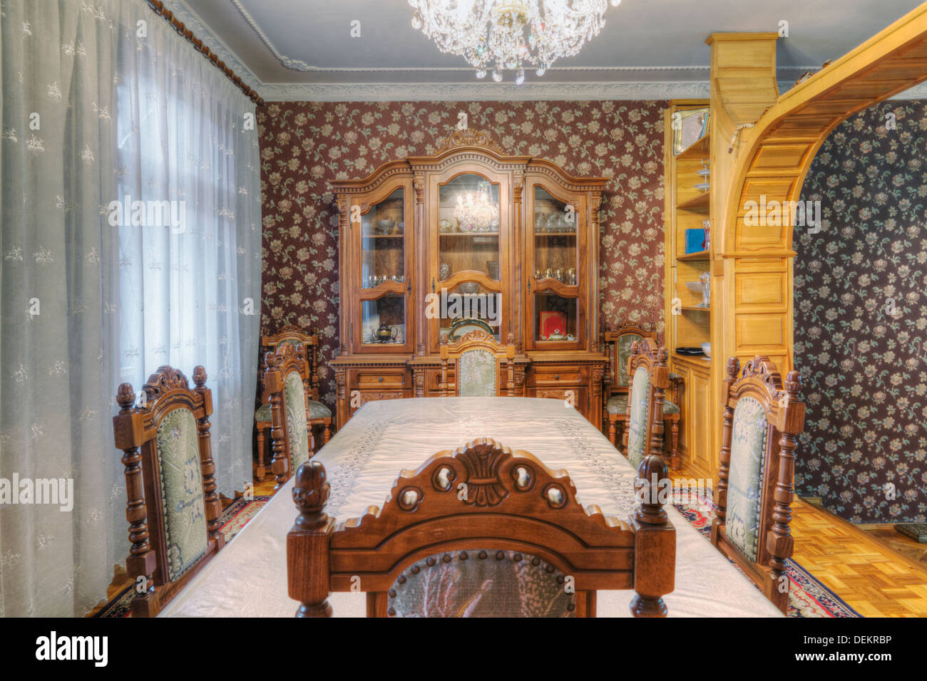 Dining table and hutch in dining room - Stock Image