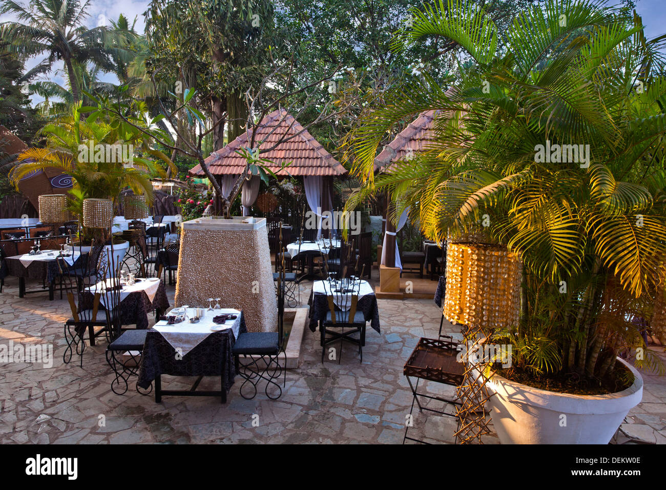 Table and chairs at a restaurant, A Reverie, Calangute, North Goa, Goa, India - Stock Image