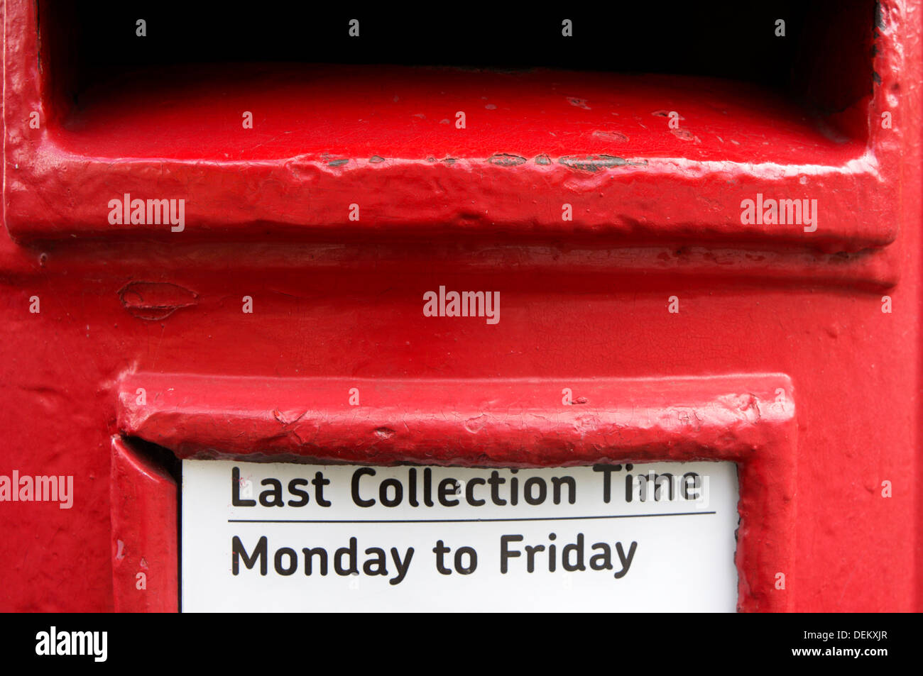 Last Collection Time displayed on a red British pillar box. - Stock Image
